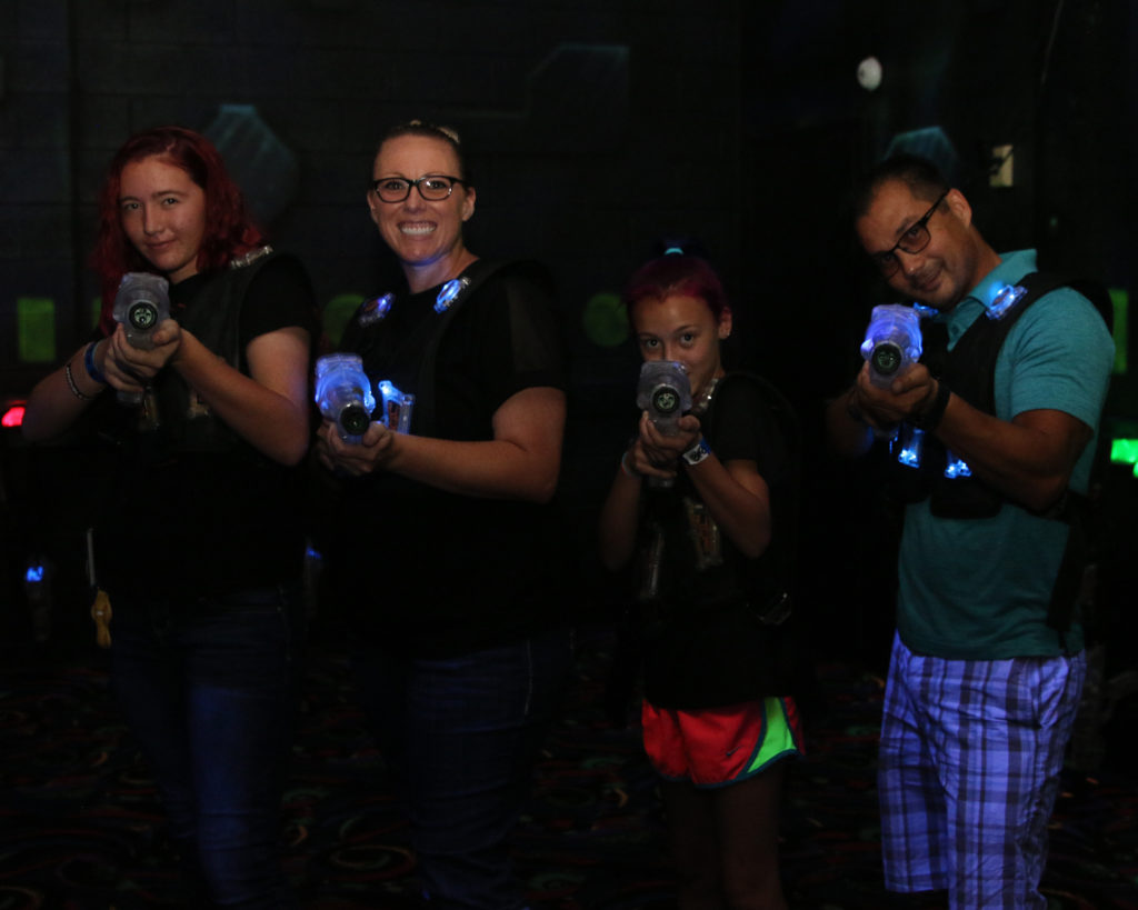 a family enjoying a game of laser tag