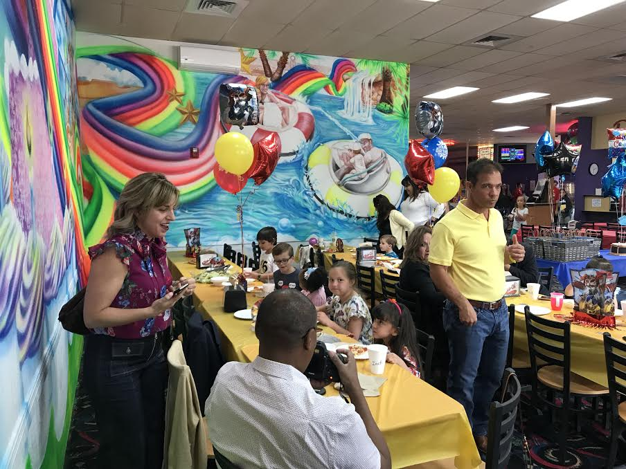 Family preparing for birthday party at family fun center.