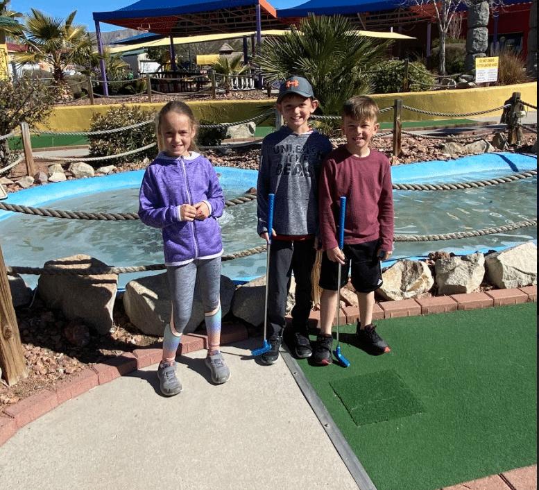 Family Enjoying a game of mini golf